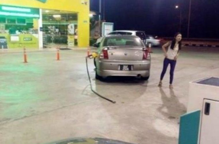 Girl driving at Gas Station