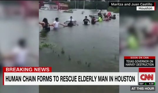 Strangers Form Human Chain To Save Elderly Man From Flooded Waters